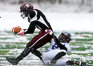 Kevin Bartram | Staff<br /> Plainville's Abbas Bell tackles Sean Dunleavy during the first half of the Thanksgiving Day game between Plainville and Farmington on Thursday at Farmington High School.