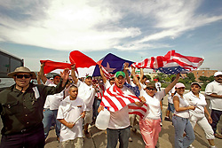 Stock photo of thousands of protesters gather this afternoon at Allen's Landing in downtown Houston to advocate the rights for immigrants.