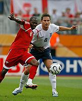Photo: Glyn Thomas.<br />England v Trinidad & Tobago. Group B, FIFA World Cup 2006. 15/06/2006.<br /> England's Frank Lampard (L) and Trinidad & Tobago's Cyd Gray.