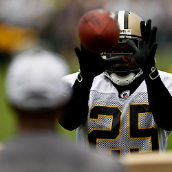 August 3, 2010; Metairie, LA, USA; New Orleans Saints running back Reggie Bush (25) catches balls from the JUGS gun during a training camp practice at the New Orleans Saints practice facility. Mandatory Credit: Derick E. Hingle
