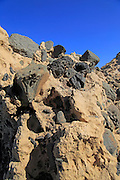 Conglomerate rock with volcanic bombs embedded in sediment, Playa de Garcey, Fuerteventura, Canary Islands, Spain