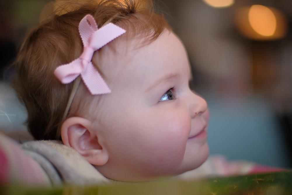 Oklahoma children's photographer Dustin Schmidt photographs a young girl at Scottie's Deli.