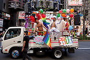 People parade in colourful costumes on a van during Tokyo Rainbow Pride festival, Yoyogi Park, Tokyo, Japan. Sunday April 27th 2014 This was the third year this annual gay-pride event has been held in Japan capital.with food, fashion and health care stalls and musical performances set up in Yoyogi Park event square and a colourful parade around Shibuya at 1pm.