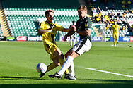 Jake Hesketh (8) of Burton Albion is tackled by Peter Grant (24) of Plymouth Argyle during the EFL Sky Bet League 1 match between Plymouth Argyle and Burton Albion at Home Park, Plymouth, England on 20 October 2018.