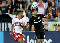 August 5, 2017 - Washington, DC, USA - 20170805 - D.C. United midfielder LAMAR NEAGLE (13) plays the ball off his head against Toronto FC midfielder RAHEEM EDWARDS (44) in the second half at RFK Stadium in Washington. (Credit Image: © Chuck Myers via ZUMA Wire)