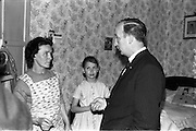 16/06/1963.06/16/1963.16 June 1963.Hendrick Street houses evacuated.  Councillor M. Mullen T.D.pleads with Mrs Keogh , No.6 Hendrick Street, to leave her house with Madeleline Keogh looking on.