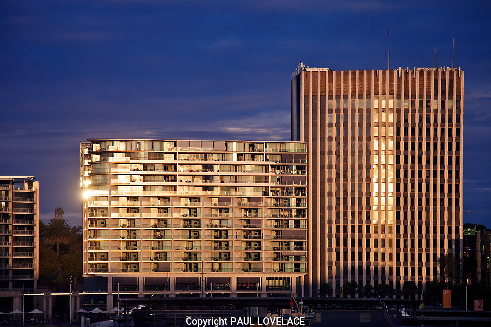 """Early evening light falls on The Bennelong Apartments also known as the """"Toaster"""" on the east side of Circular Quay, Sydney, Australia."""