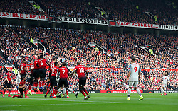 Liverpool's Mohamed Salah (right) takes a free kick but sees his shot go over the bar during the Premier League match at Old Trafford, Manchester.