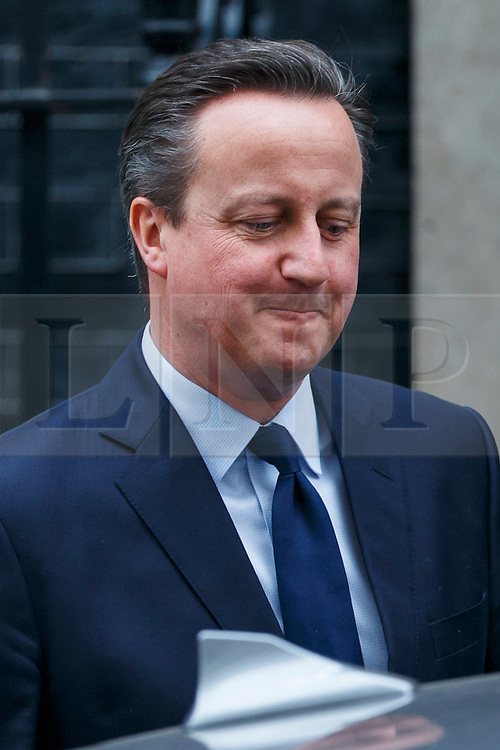 © Licensed to London News Pictures. 21/03/2016. London, UK. Prime Minister David Cameron leaving Downing Street to attend House of Commons in London on Monday, 21 March 2016. Photo credit: Tolga Akmen/LNP