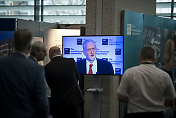 © Licensed to London News Pictures. 20/02/2018. London, UK. Conference gusts watch as Labour party leader JEREMY CORBYN MP delivers a speech at the EEF National Manufacturing Conference 2018 held at the QEII conference centre in London. Photo credit: Ben Cawthra/LNP