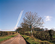 The 'Red Arrows', Britain's Royal Air Force aerobatic team, perform steep climb over the Lincolnshire landscape near RAF Scampton