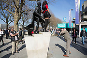 Two models wearing Deborah Azzopardi outfits are photographed on the statue of Sir Laurence Olivier. The South Bank is a significant arts and entertainment district, and home to an endless list of activities for Londoners, visitors and tourists alike.