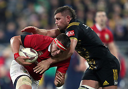 British and Irish Lions' CJ Stander is tackled during the tour match at the Westpac Stadium, Wellington.