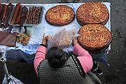 Armenia, Azat Valley, Monastery of Geghard, Women sell traditional sweet bread