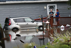 Flooding in Round Lake Beach, Ill. strands cars, people and their home on Wednesday, July 12, 2017. Photo by Joe Shuman/Chicago Tribune/TNS/ABACAPRESS.COM