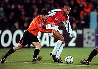 Thierry Henry (Arsenal) Dainius Gleveckas (Shakhtar Donetsk). Shakhtar Donetsk 3:0 Arsenal, UEFA Champions League, Group B, Centralny Stadium, Donetsk, Ukraine, 7/11/2000. Credit Colorsport / Stuart MacFarlane.