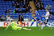 Cardiff City's Kenneth Zohore © shoots and scores his teams 1st goal past Fulham's 'keeper (27) David Button. EFL Skybet championship match, Cardiff city v Fulham at the Cardiff city stadium in Cardiff, South Wales on Saturday 25th February 2017.<br /> pic by Carl Robertson, Andrew Orchard sports photography.