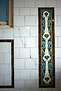 Period tiling at Manze's Eel, Pie and Mash shop in Walthamstow, East London, UK.Although the shop still trades under the original Manze name, it is now independently owned and no longer part of the Manze family.Eel, pie and mash shops are a traditional but dying business. Changing tastes and the scarcity of the eel has meant that the number of shops selling this traditional working class food has declined to just a handful mostly in east London. The shops were originally owned by one or two families with the earliest recorded, Manze's on Tower Bridge Road being the oldest surviving dating from 1908. Generally eels are sold cold and jellied and the meat pie and mash potato covered in a green sauce called liquor.