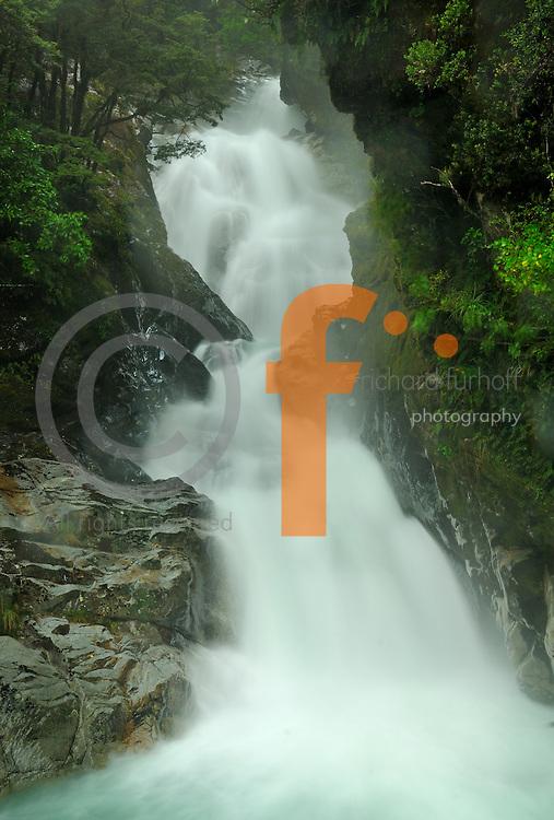 Richard Furhoff 100101_NewZealand_DSC4611.tif .Swollen Falls After Rain, Fiordlands National Park. New Zealand. ..