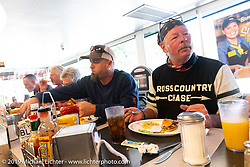 Chris Tribbey (R) and Rodney Sterling (L) at a Waffle House lunch during the Cross Country Chase motorcycle endurance run from Sault Sainte Marie, MI to Key West, FL. (for vintage bikes from 1930-1948). Stage-6 from Chattanooga, TN to Macon, GA USA covered 258 miles. Wednesday, September 11, 2019. Photography ©2019 Michael Lichter.