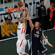 Anadolu Efes's Dusko Savanovic (R) and Olympiacos's Pero Antic (L) during their Turkish Airlines Euroleague Basketball Top 16 Group E Game 4 match Anadolu Efes between Olympiacos at Sinan Erdem Arena in Istanbul, Turkey, Wednesday, February 08, 2012. Photo by TURKPIX