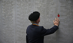 Gerry Crozier, 2nd Royal Tank Regiment, touches a memorial wall at a Wreath Laying ceremony to commemorate Armistice Day at the Glasnevin cemetery in Dublin.