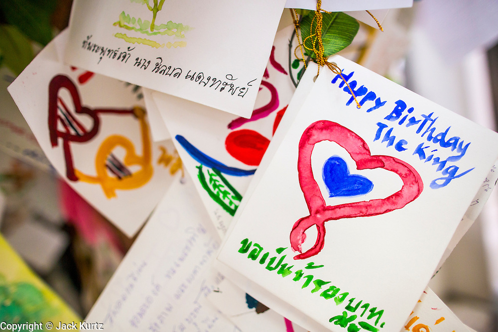 26 NOVEMBER 2012 - BANGKOK, THAILAND:  Birthday cards left for Bhumibol Adulyadej, the King of Thailand, at Siriraj Hospital in Bangkok. Siriraj was the first hospital in Thailand and was founded by King Chulalongkorn in 1888. It is named after the king's 18-month old son, Prince Siriraj Kakuttaphan, who had died from dysentery a year before the opening of the hospital. It's reported to one of the best hospitals in Thailand and has been home to Bhumibol Adulyadej, the King of Thailand, since 2009, when he was hospitalized to treat several ailments. Since his hospitalization tens of thousands of people have come to pay respects and offer get well wishes. The King's 85th birthday is on Dec 5 and crowds at the hospital are growing as his birthday approaches. The King is much revered throughout Thailand and is seen as unifying force in the politically fractured country.       PHOTO BY JACK KURTZ