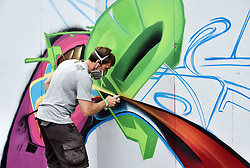 © Licensed to London News Pictures.  29/07/2017; Bristol, UK. Upfest 2017. Works  in progress by artists in Ashton Gate Stadium at Upfest, Europe's largest street art festival held annually in Bedminster, Bristol. The festival officially runs from 29 - 31 July with over 350 artists live painting in 37 locations including this Ashton Gate stadium, home of Bristol City FC. Picture credit : Simon Chapman/LNP