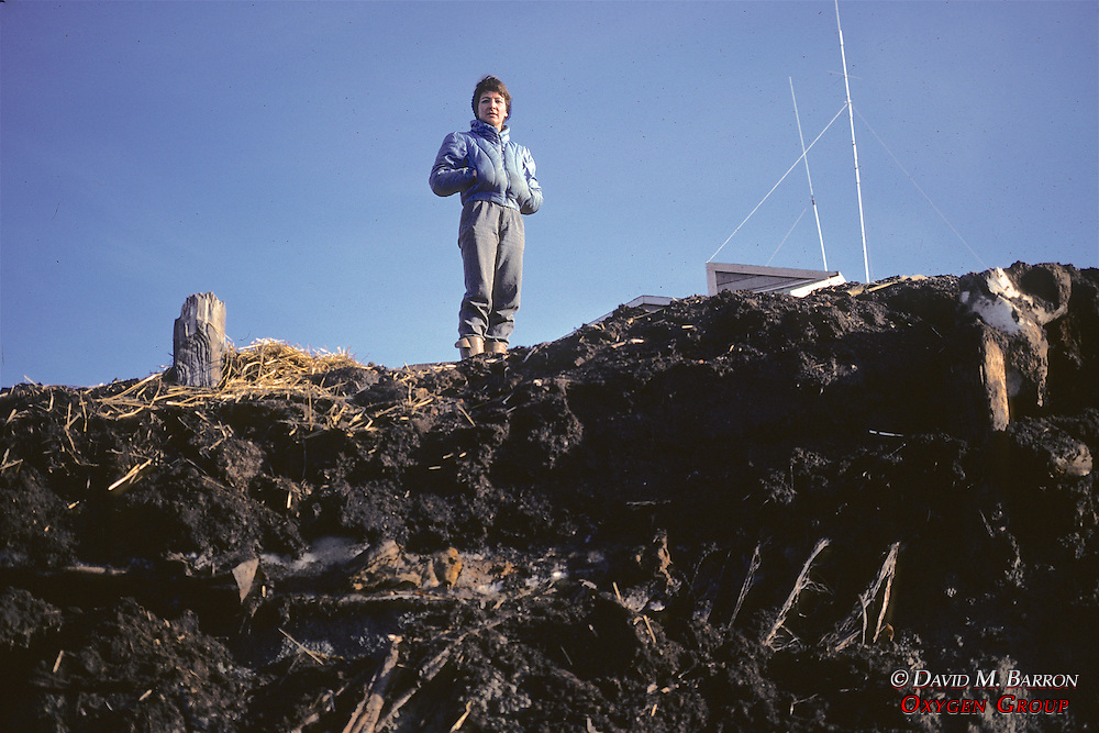 Lynda Plettner Standing Above 400 Year Old Man Discovered In Cliffs After Storm Washed Away Permafrost