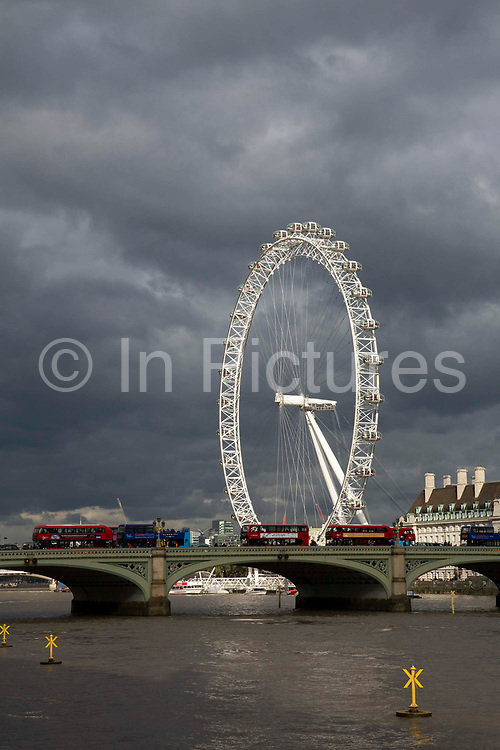 The Coco-cola  London Eye set against a moody London sky is the worlds largest  ferris wheel, situated on the South bank of the River Thames in London. Designed by Marks Barfiled Architects and currently owned by London Eye Management Services. London, 19th October 2016.