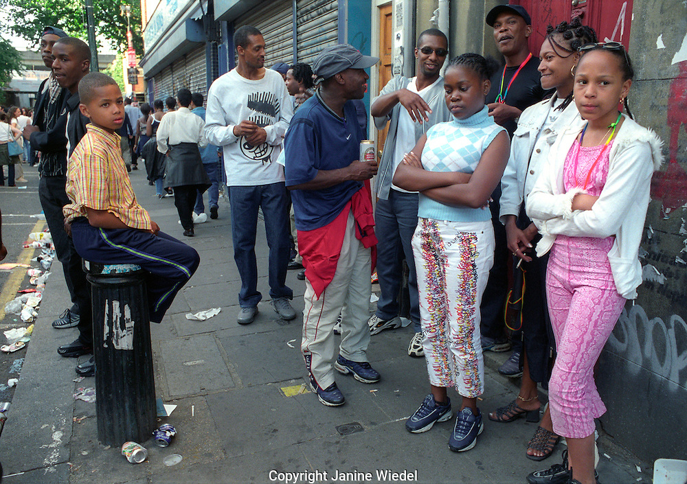 Racially mixed group of young people socialising in the streets of London.