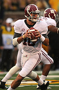 Alabama Crimson Tide quarterback AJ McCarron (10) looks for a receiver in first half action. The Alabama Crimson Tide defeated the Missouri Tigers 42-10 at Memorial Stadium in Columbia, Missouri on October 13, 2012.