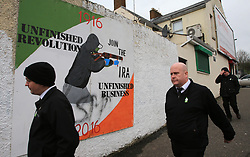 © Licensed to London News Pictures. 23/03/2017. Londonderry, UK. People walk pass a IRA mural in the Bogside area of Londonderry, Northern Ireland Thursday, March 23, 2017 ahead of the funeral of Sinn Féin's Martin McGuinness. Mr McGuinness, a former IRA leader turned politician, died on Tuesday.. Photo credit: LNP