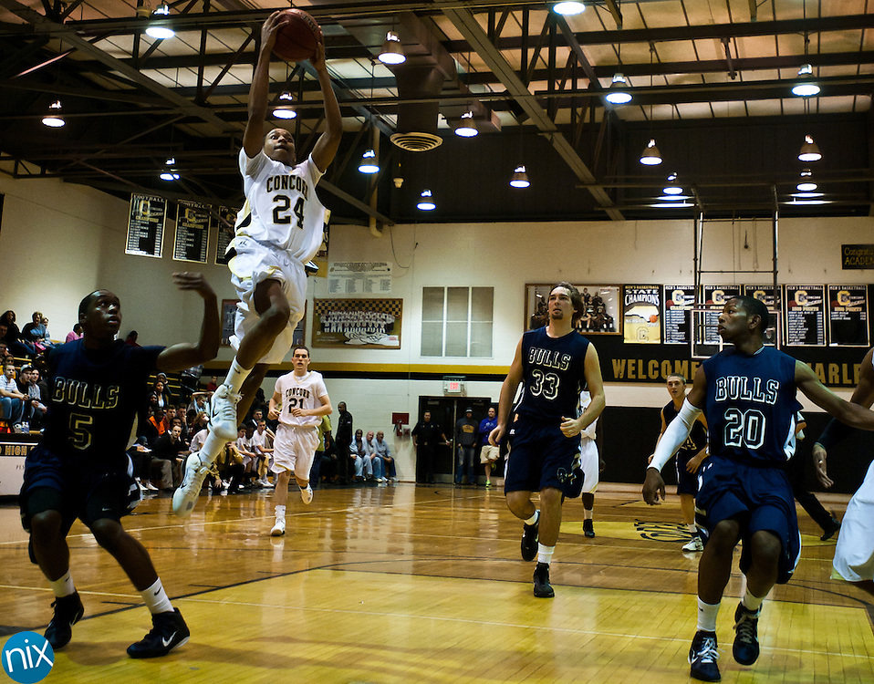 Concord's Darren Black goes up for a shot against Hickory Ridge Tuesday night at Concord High School. The Spiders won the South Piedmont Conference matchup 89-41(Photo by James Nix)