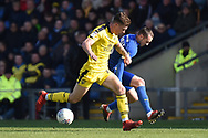 Oxford United midfielder Josh Ruffels (14) battles for possession with AFC Wimbledon midfielder Dylan Connolly (16)during the EFL Sky Bet League 1 match between Oxford United and AFC Wimbledon at the Kassam Stadium, Oxford, England on 13 April 2019.