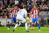 Atletico de Madrid's player Ángel Martín Correa and Juanfran Torres and Malaga CF Mikel Villanueva Alvarez during a match of La Liga Santander at Vicente Calderon Stadium in Madrid. October 29, Spain. 2016. (ALTERPHOTOS/BorjaB.Hojas)