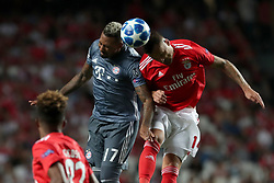 September 19, 2018 - Lisbon, Portugal - Bayern Munich's defender Jerome Boateng from Germany (C ) heads the ball with Benfica's Suisse forward Haris Seferovic during the UEFA Champions League Group E football match SL Benfica vs Bayern Munich at the Luz stadium in Lisbon, Portugal on September 19, 2018. (Credit Image: © Pedro Fiuza/ZUMA Wire)