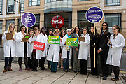 Oxfam supporters outside Coca Cola headquarters, calling for the company to tighten its supply chain so that the ingredients Coca Cola uses in its products are not grown on land that has been grabbed from poor communities
