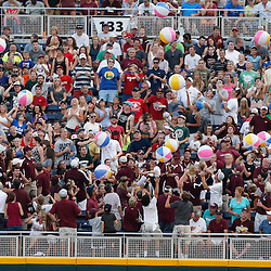 Jun 24, 2013; Omaha, NE, USA; Fans toss beach balls during the second inning in game 1 of the College World Series finals against the Mississippi State Bulldogs at TD Ameritrade Park. Mandatory Credit: Derick E. Hingle-USA TODAY Sports