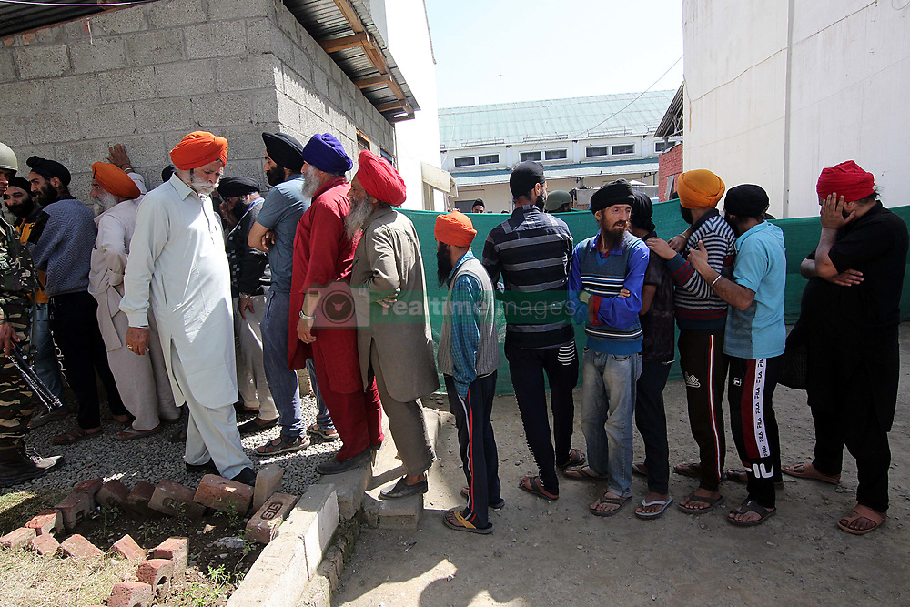 April 29, 2019 - Srinagar, India - Sikhs stand in queue to cast their votes outside the polling station during the second leg of the three-phased voting schedule for the Lok Sabha seat in south Kashmir's Kulgam on April 29, 2019.Indian general election which began on 11 April will continue till 19 May 2019 to constitute the 17th Lok Sabha. The counting of votes will be conducted on 23 May, and on the same day the results will be declared. (Credit Image: © Faisal Khan/NurPhoto via ZUMA Press)
