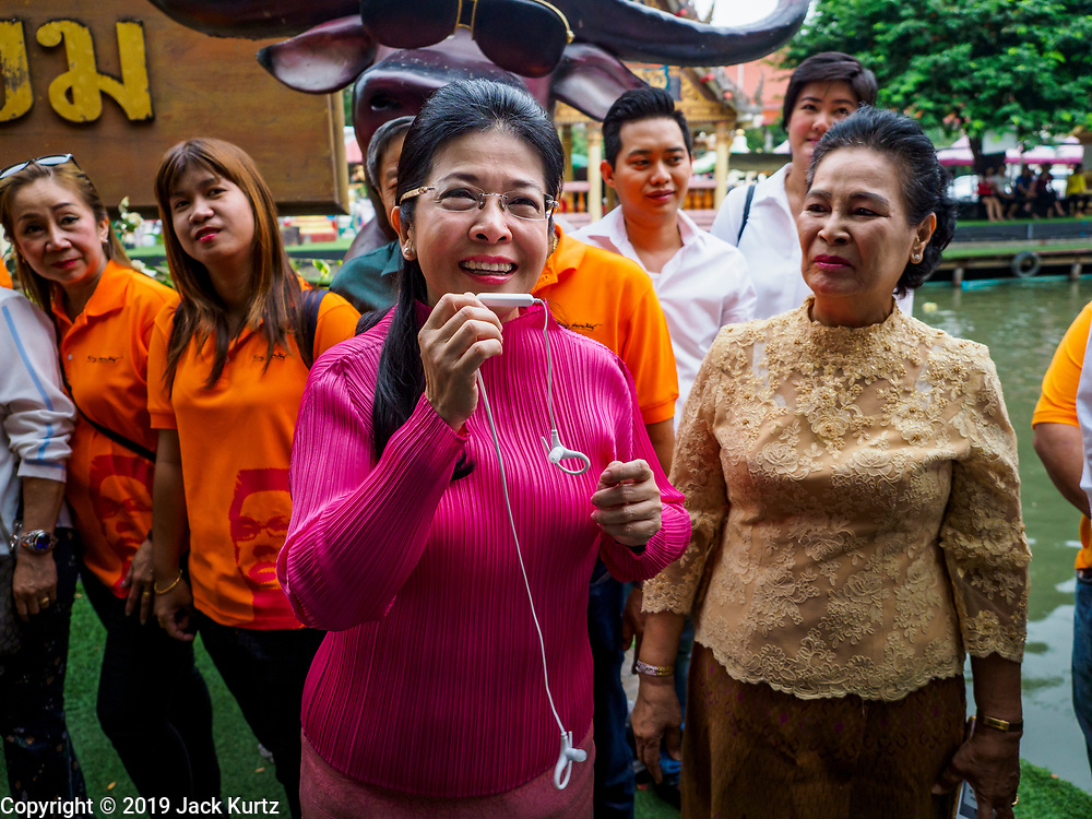 05 JANUARY 2019 - MINBURI, BANGKOK, THAILAND: SUDARAT KEYURAPHAN (pink blouse), the Pheu Thai Party candidate for Prime Minister of Thailand, meets voters at the Kwan Riam Floating Market at Wat Bamphen Nuea in Minburi, east of downtown Bangkok. The Thai government has tentatively scheduled a general election for 24 February 2019. It will be Thailand's first election since a military coup overthrew the government of Yingluck Shinawatra in 2014. Yingluck was a the leader of the Pheu Thai Party before her ouster. Sudarat was a member of Thaksin Shinawatra's cabinet. Thaksin's government was also deposed by a coup in 2006.       PHOTO BY JACK KURTZ