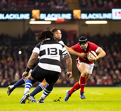 Leigh Halfpenny of Wales under pressure from Curwin Bosch of Barbarians <br /> <br /> Photographer Simon King/Replay Images<br /> <br /> Friendly - Wales v Barbarians - Saturday 30th November 2019 - Principality Stadium - Cardiff<br /> <br /> World Copyright © Replay Images . All rights reserved. info@replayimages.co.uk - http://replayimages.co.uk