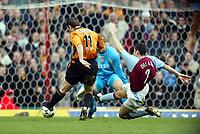 Photograph: Scott Heavey, Digitalsport<br /> Aston Villa v Wolverhampton Wanderers. FA Barclaycard Premiership. 14/12/2003.<br /> Mark Kennedy slots home Wolves second