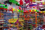 Garish merchandising, confectionary stock and shop fittings in American Candy, on Oxford Street, on 22nd November 2017, in London England.