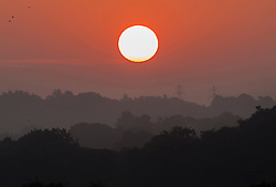 © Licensed to London News Pictures. 14/09/2016. London, UK. SA sunrise over the south east, seen from Surrey, heralds the start of another exceptionally hot September day. Photo credit: Peter Macdiarmid/LNP