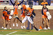Oct 23, 2010; Charlottesville, VA, USA;  Virginia Cavaliers safety Trey Womack (1) runs in for a touchdown on a fake punt attempt during the 2nd half of the game against the Eastern Michigan Eagles at Scott Stadium. Virginia won 48-21. Mandatory Credit: Andrew Shurtleff