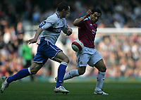 Photo: Lee Earle.<br /> West Ham United v Middlesbrough. The Barclays Premiership. 31/03/2007.United's Carlos Tevez (R) is tracked by Emanuel Pogatetz.