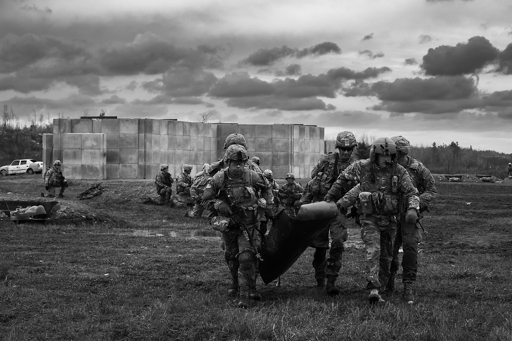 1BCT, 10th Mountain Division Soldiers evacuate a casualty to a waiting MEDEVAC Helicopter during a Field Training Exercise.  Ft. Drum, NY