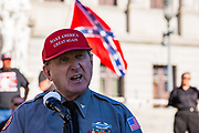 Harrisburg, PA -- Arthur Jones, wearing a Make America Great Again hat, speaks at a 2016 rally of white supremacists at the Pennsylvania State Capitol.