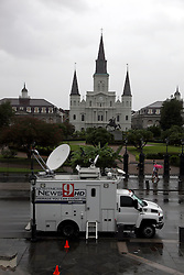 28 August 2012. New Orleans, Louisiana,  USA. <br /> A media broadcast truck parks in an almost deserted Jackson Square in the heart of the French Quarter as the media descends on the city to cover Hurricane Isaac. The 7th year anniversary of Hurricane Katrina is tomorrow and with a storm lurking in the Gulf many have evacuated as an uneasy calm settles over New Orleans.<br /> Photo; Charlie Varley